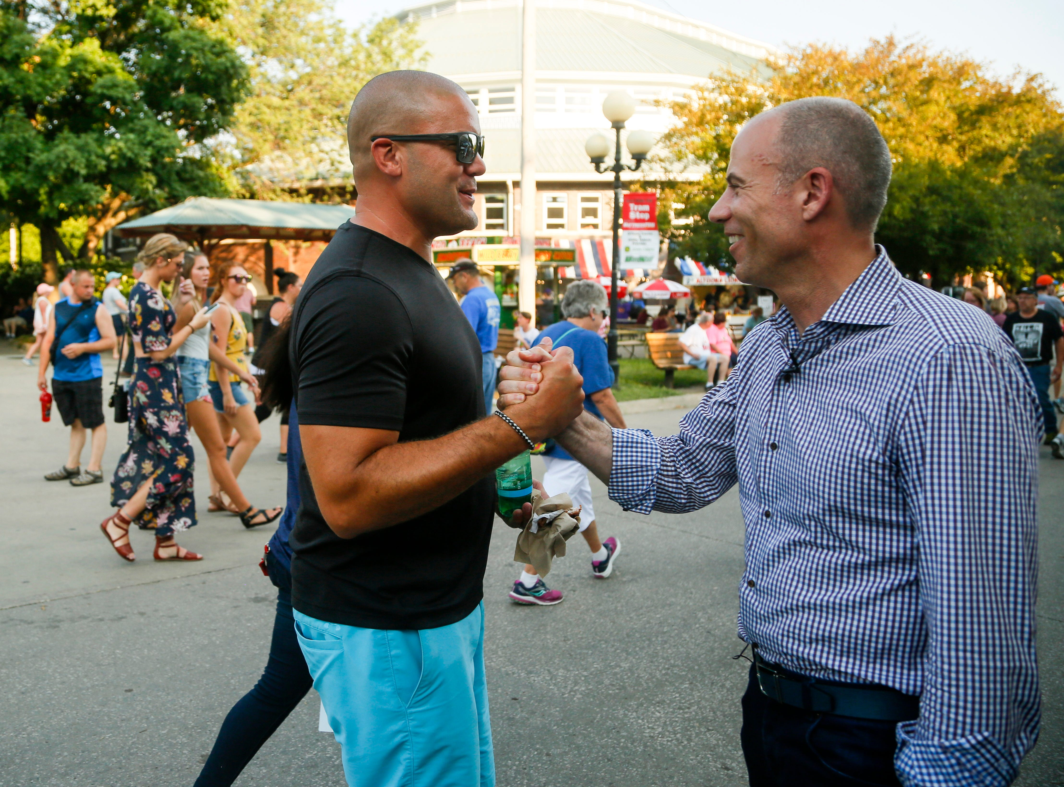 Michael Avenatti, the lawyer known for representing adult film actress Stormy Daniels in her case against President  Donald Trump shakes hands at the Iowa State Fair Thursday, Aug. 9, 2018.