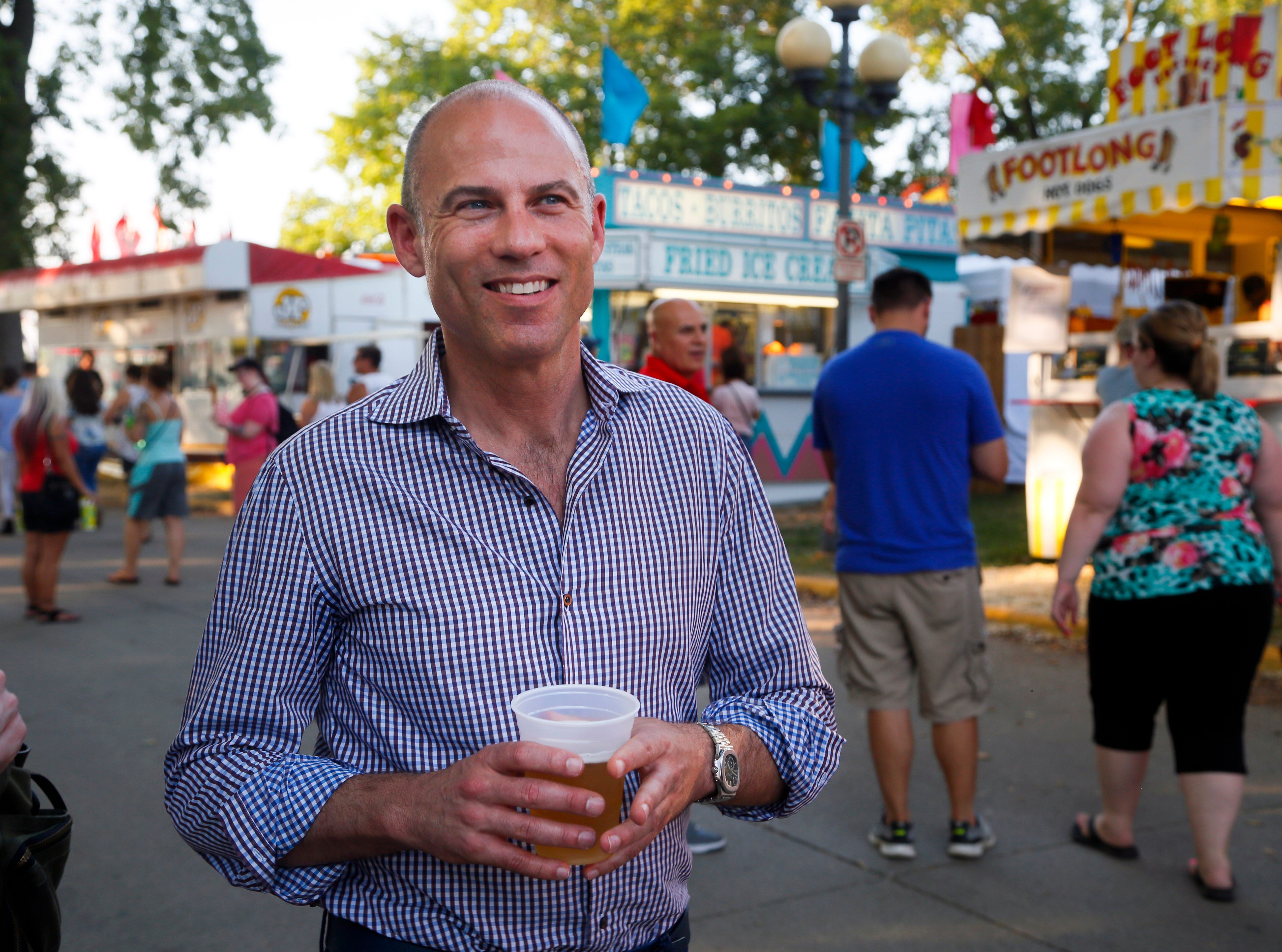 Michael Avenatti, the lawyer known for representing adult film actress Stormy Daniels in her case against President  Donald Trump drinks a beer at the Iowa State Fair Thursday, Aug. 9, 2018.