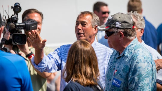Former Speaker of the U.S. House of Representatives John Boehner talks with Democrat John Delaney, a presidential hopeful, at the Des Moines Register Political Soapbox at the Iowa State Fair on Friday, Aug. 10, 2018, in Des Moines, Iowa.
