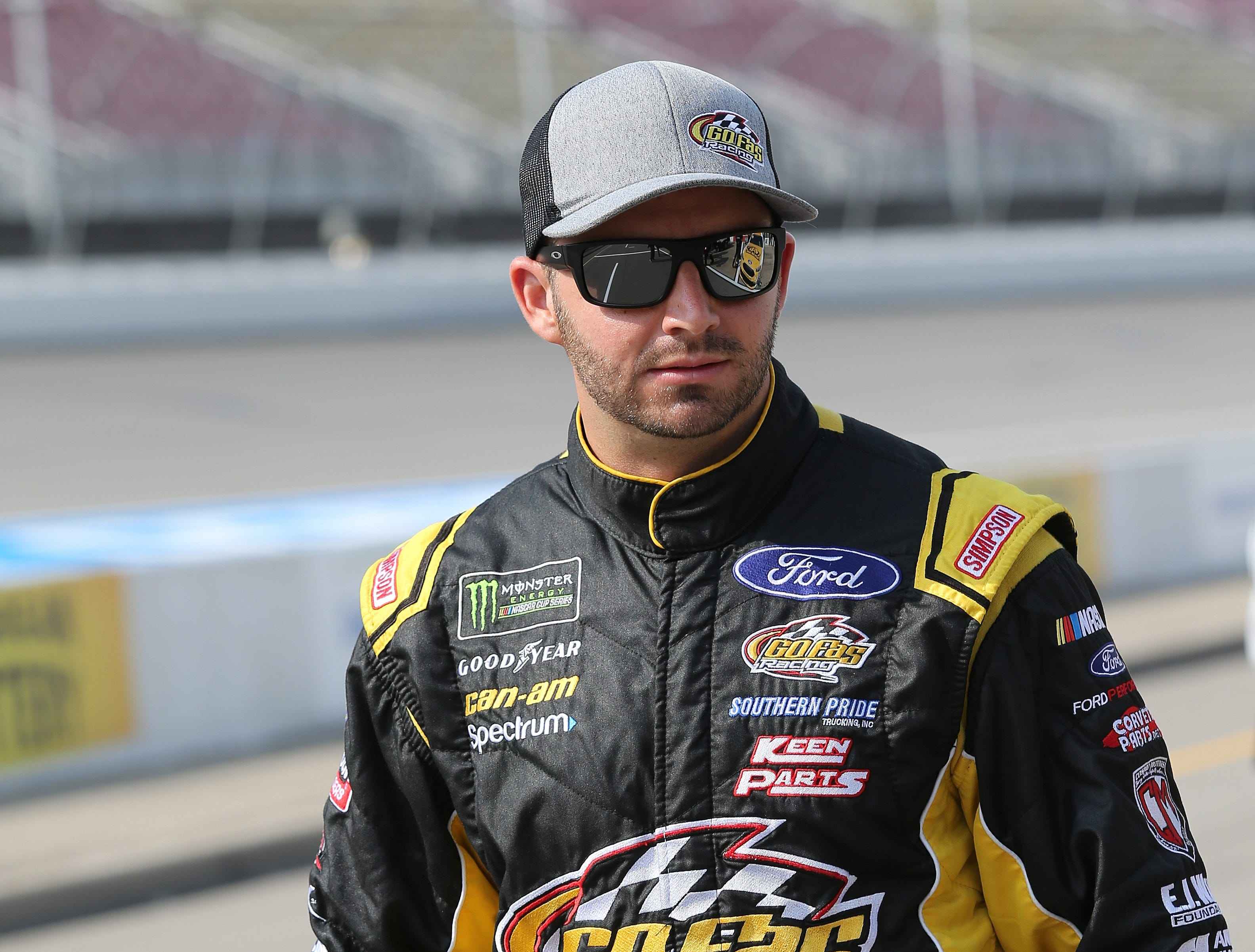 Matt DiBenedetto, driver of the #32 Harvest Investments & Properties Ford, walks to his car during qualifying for the Monster Energy NASCAR Cup Series Consmers Energy 400 at Michigan International Speedway on August 10, 2018 in Brooklyn, Michigan.