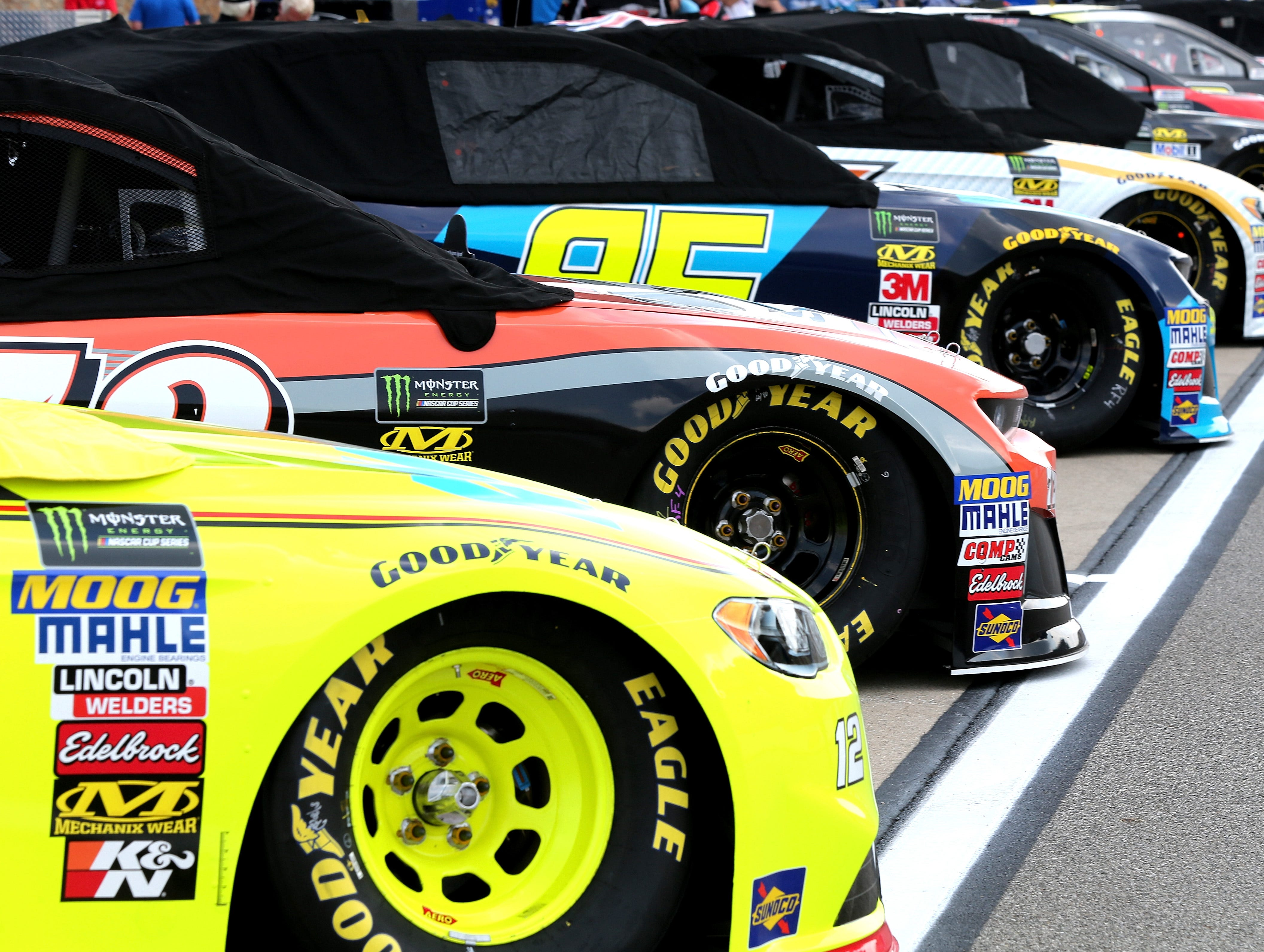 Cars sit on pit road during qualifying for the Monster Energy NASCAR Cup Series Consmers Energy 400 at Michigan International Speedway on August 10, 2018 in Brooklyn, Michigan.