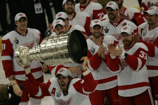Red Wings forward Henrik Zetterberg hoists the Stanley Cup after the 3-2 victory in Game 6 of the Stanley Cup finals on Wednesday, June 4, 2008, in Pittsburgh.