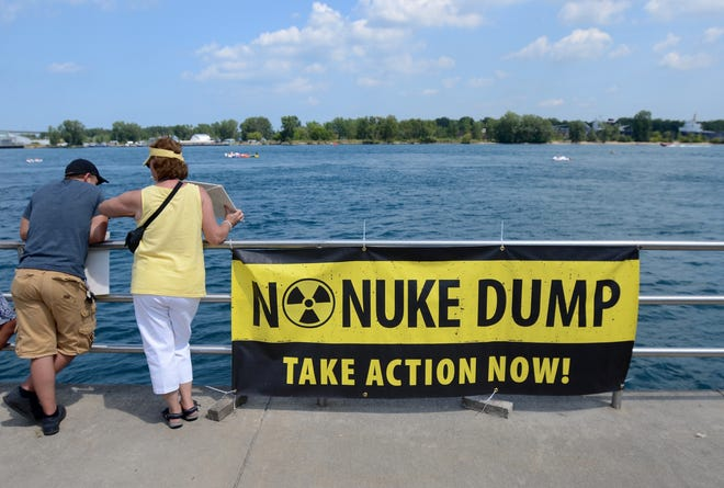 A sign hangs on the boardwalk protesting against the proposed nuclear dump site on Lake Huron Sunday during the 2015 International Rally to Protect the Great Lakes at Pine Grove Park in Port Huron. ANDREW JOWETT/TIMES HERALD