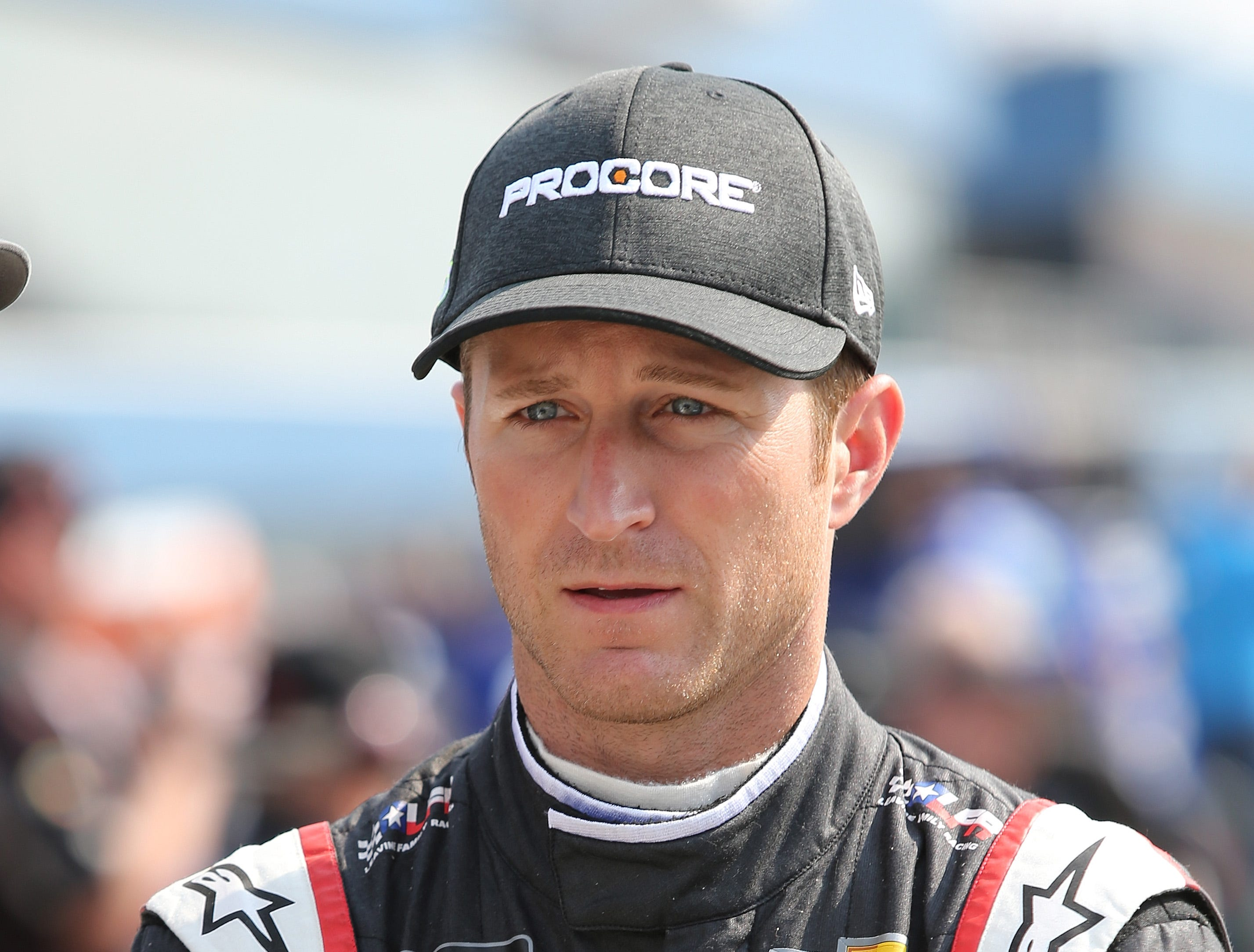 Kasey Kahne, driver of the #95 WRL General Contractors Chevrolet, stands by his car during qualifying for the Monster Energy NASCAR Cup Series Consmers Energy 400 at Michigan International Speedway on August 10, 2018 in Brooklyn, Michigan.
