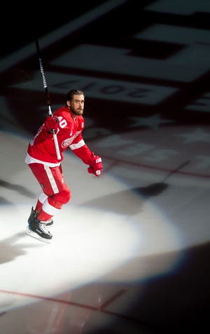 Red Wings captain Henrik Zetterberg skates onto the ice as he is introduced prior to the home opener at Joe Louis Arena on Oct. 17, 2016.