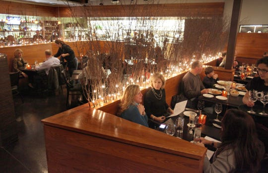 Patrons dine at The Root Restaurant & Bar in White Lake, the 2012 Detroit Free Press Restaurant of the Year.