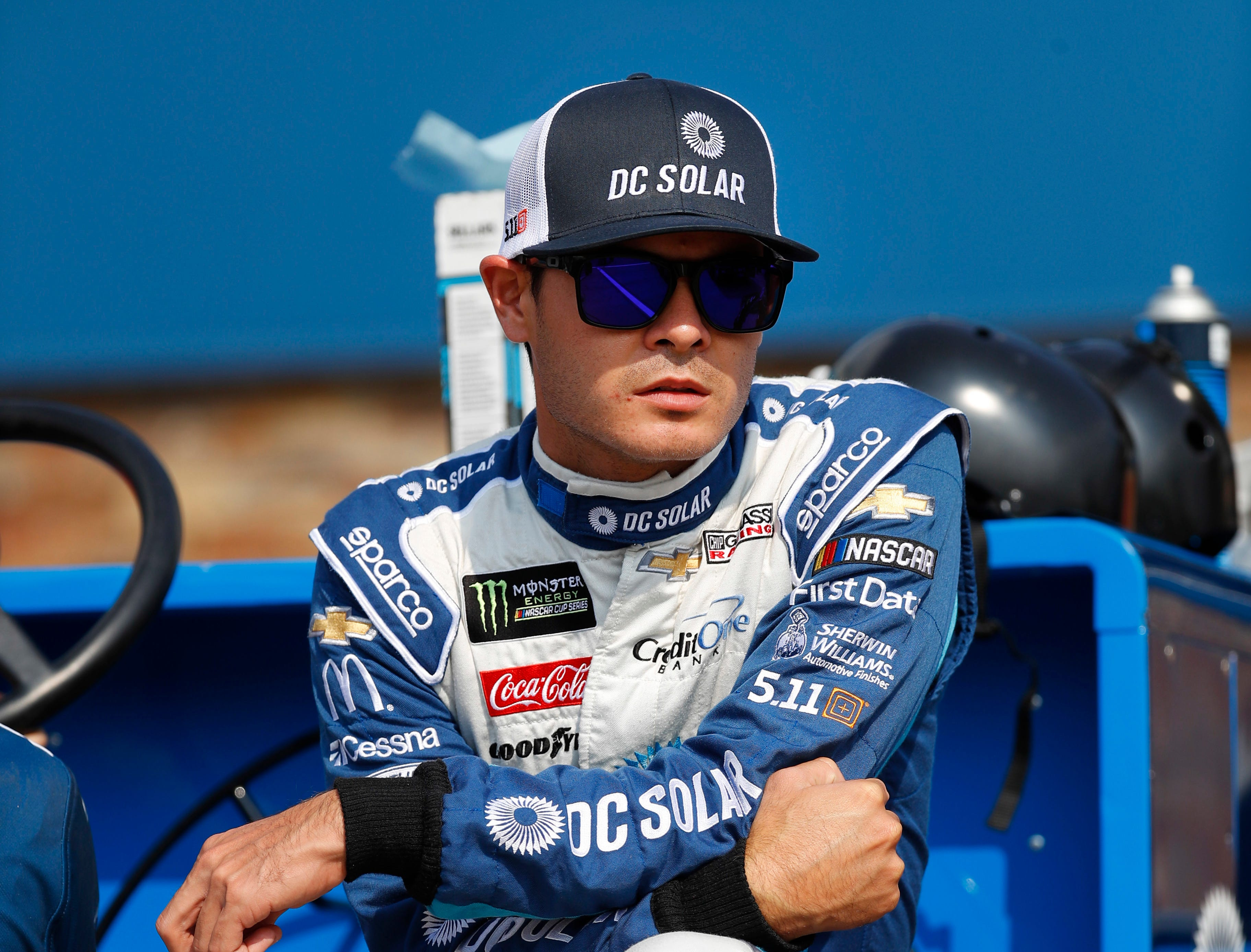 Kyle Larson watches before qualifications for a NASCAR Cup Series auto race at Michigan International Speedway in Brooklyn, Mich., Friday, Aug. 10, 2018.