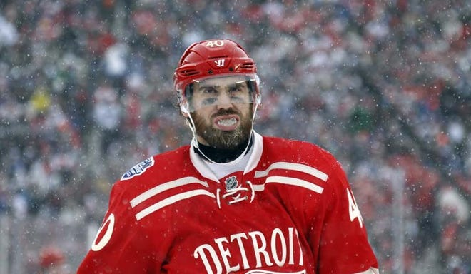 Red Wings forward Henrik Zetterberg skates on the ice during second period action against the Maple Leafs during theWinter Classic at Michigan Stadium in Ann Arbor on Jan. 1, 2014.
