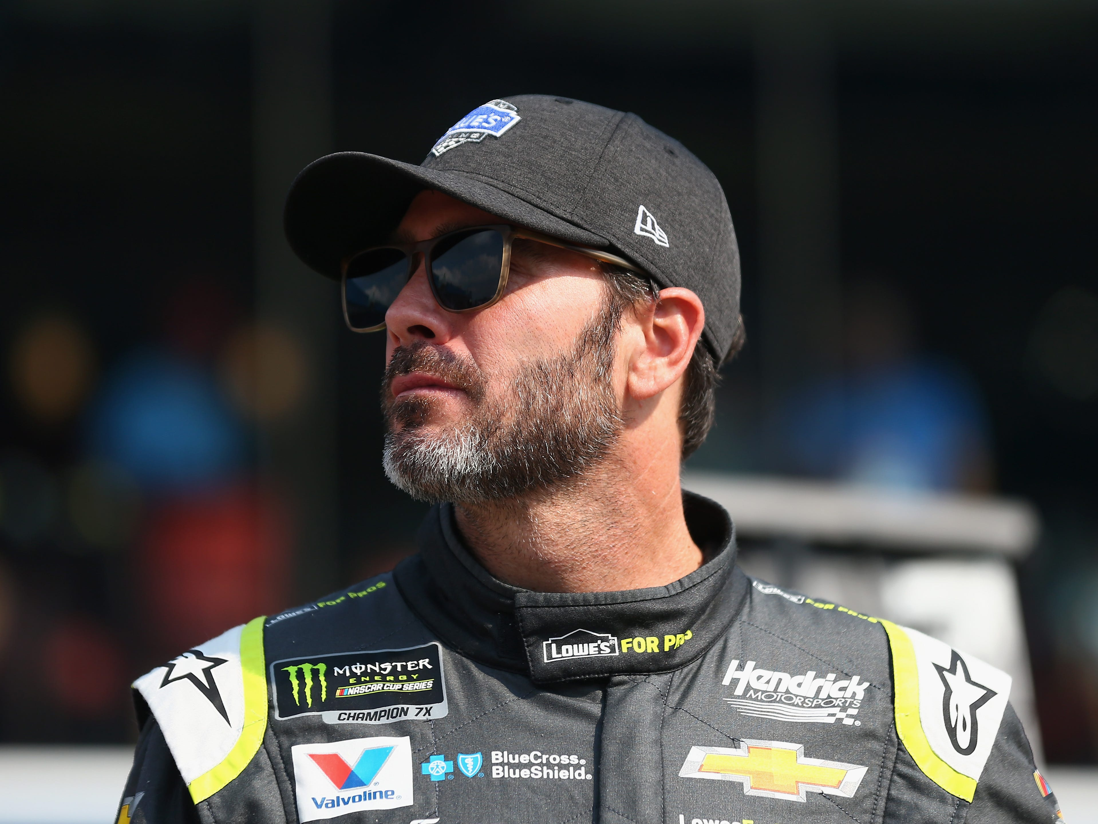 1014704852.jpg BROOKLYN, MI - AUGUST 10:  Jimmie Johnson, driver of the #48 Lowe's for Pros Chevrolet, stands on the grid during qualifying for the Monster Energy NASCAR Cup Series Consmers Energy 400 at Michigan International Speedway on August 10, 2018 in Brooklyn, Michigan.  (Photo by Sarah Crabill/Getty Images)