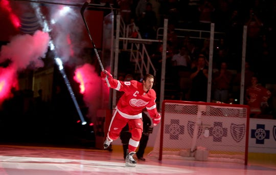 Red Wings forward Henrik Zetterberg is introduced before the opener against the Buffalo Sabres Wednesday, Oct. 2, 2013 at Joe Louis Arena.
