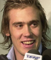 Henrik Zetterberg, the Detroit Red Wings' 1999 draft pick, answers reporters questions Thursday, May 16, 2002, at Joe Louis Arena in Detroit.