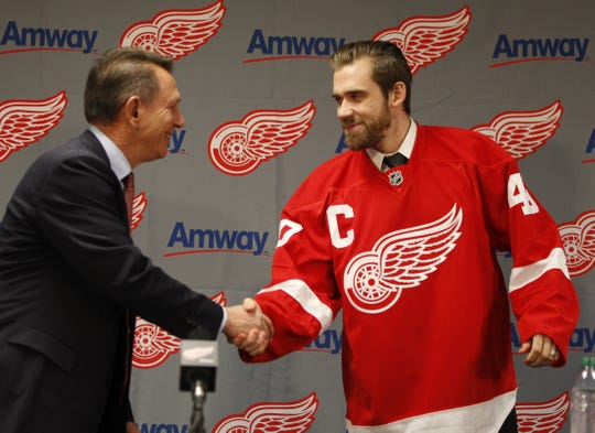 Red Wings general manager Ken Holland congratulates Henrik Zetterberg after receiving his new captains jersey during a news conference  at Compuware Arena in Plymouth on Tuesday, Jan. 15, 2013.