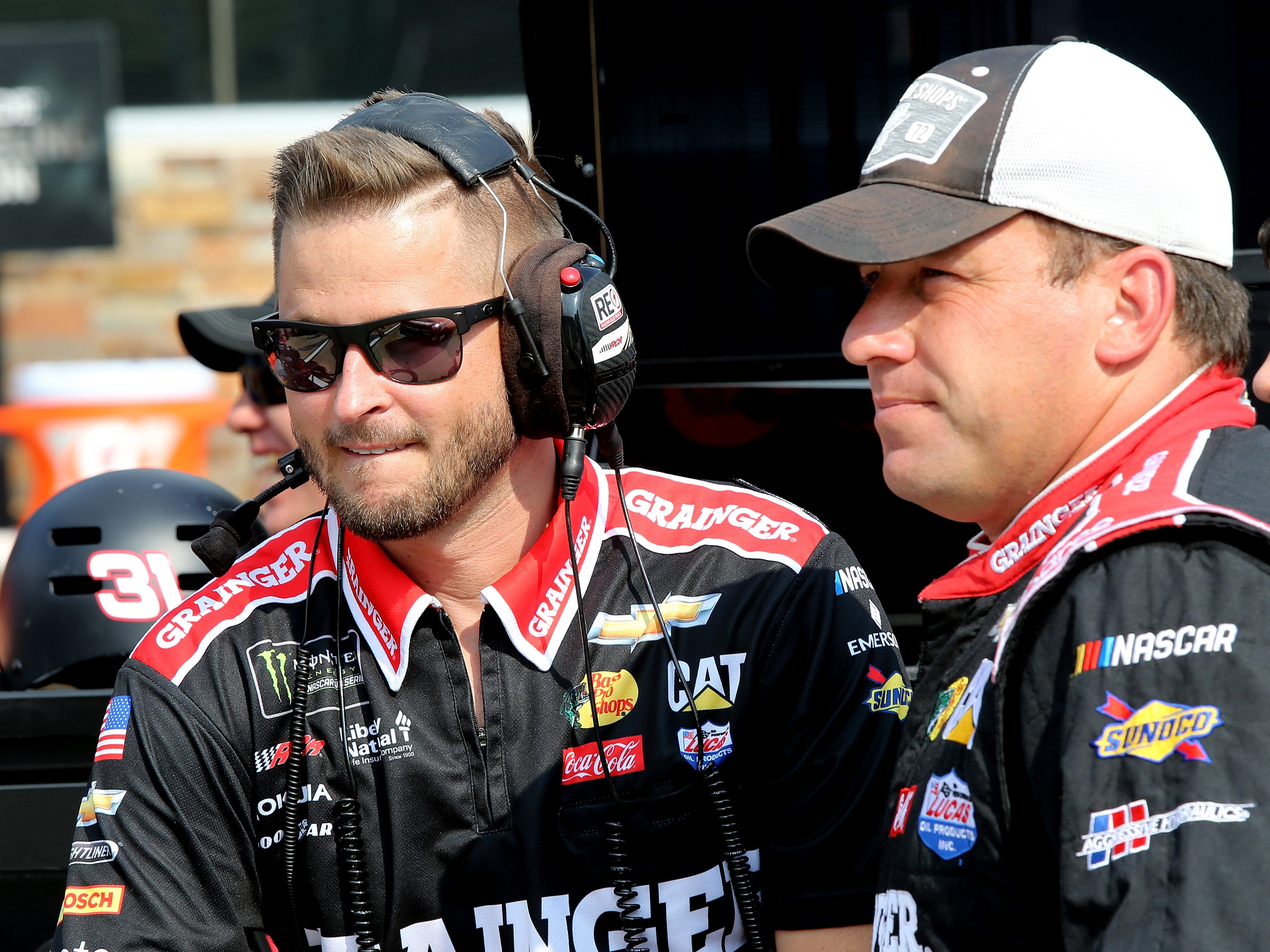 Ryan Newman, driver of the #31 Grainger Chevrolet, talks with a crew member during qualifying for the Monster Energy NASCAR Cup Series Consmers Energy 400 at Michigan International Speedway on August 10, 2018 in Brooklyn, Michigan.