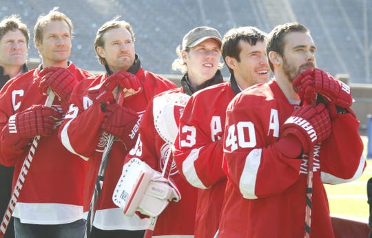 Detroit Red Wings watch a video on the big screen at Michigan Stadium during the National Hockey League's Press conference for next season Detroit area  Winter Classic at Michigan Stadium In Detroit on Thursday, February 9, 2012. L-R are head coach Mike Babcock, captain Nicklas Lidstrom, Niklas Kronwall, goalie Jimmy Howard, Pavel Datsyuk, and Henrik Zetterberg.  JULIAN H. GONZALEZ/Detroit Free Press