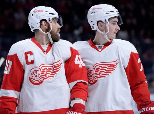 Red Wings forwards Henrik Zetterberg, left, and Dylan Larkin take a breather during the third period against the Montreal Canadiens at the Bell Centre on March 29, 2016.