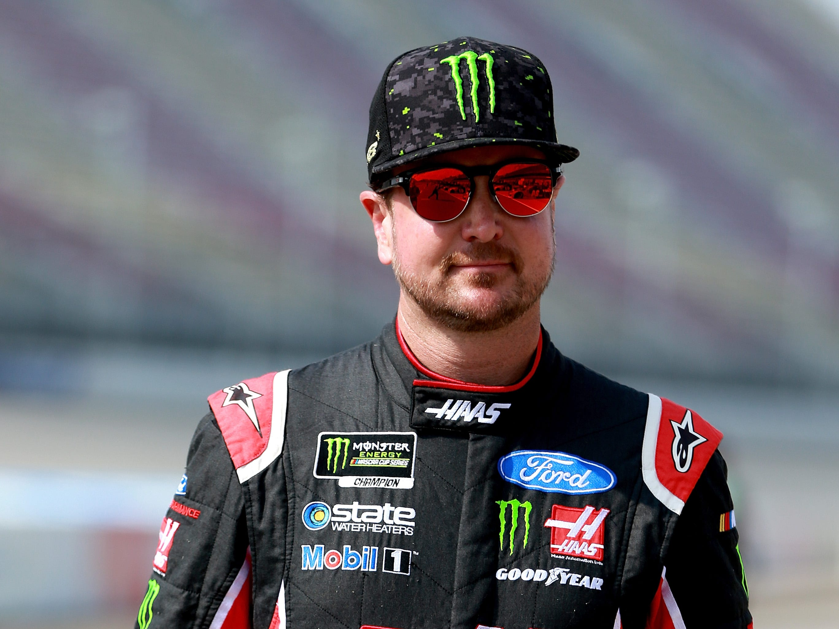 Kurt Busch, driver of the #41 Haas Automation Ford, walks on the grid during qualifying for the Monster Energy NASCAR Cup Series Consmers Energy 400 at Michigan International Speedway on August 10, 2018 in Brooklyn, Michigan.