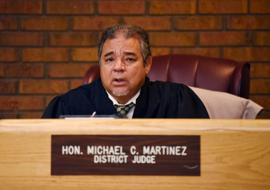 Judge Michael C. Martinez listens during the hearing for Nathaniel Abraham on August 10, 2018.