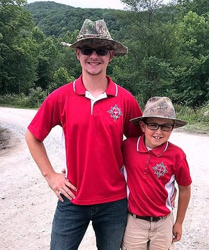 Troy Junior Sportsmen member Colton Pierce, left, was the top shooter in last month's NRA Youth Hunter Education Challenge national championship. Joining Pierce is teammate Alex Wilcox.