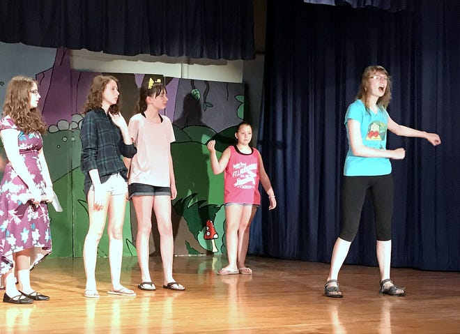 "Student actors rehearse a scene from ""Oz,"" a production of the Horseheads Youth Bureau summer drama program."