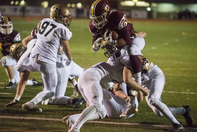Windsor High School junior fullback Noah Montague (24) pushes through a defender to score a touchdown against Monarch High School on Friday, Oct. 13, 2017, at Windsor High School in Windsor, Colo.