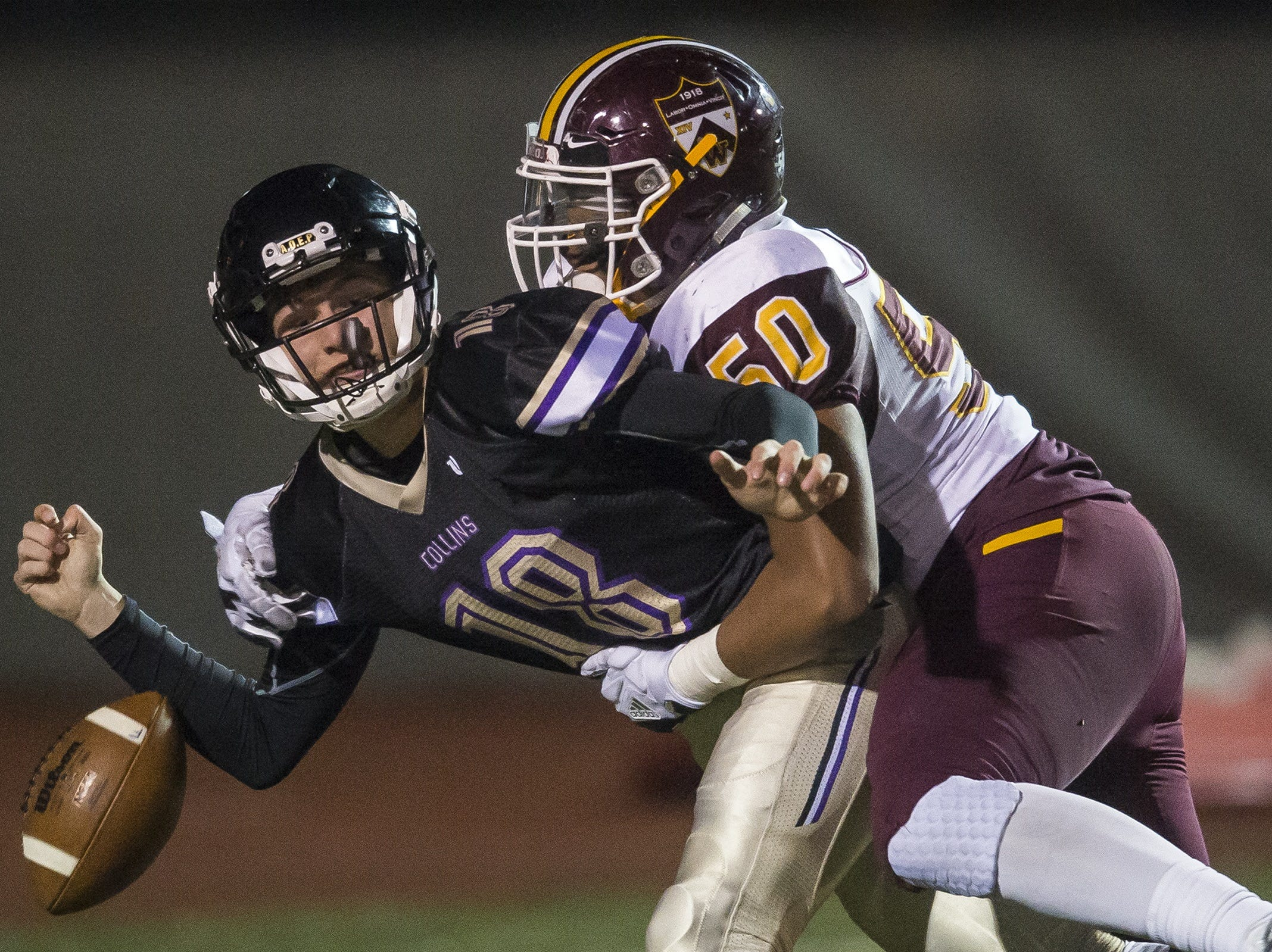 Windsor High School junior defensive lineman Avery Westphal (50) sacks and strips Fort Collins High School sophomore quarterback Hayden Iverson (18) on Friday, Nov. 3, 2017, at French Field in Fort Collins, Colo.