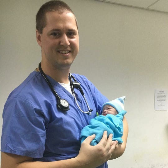 Lee Coghill delivering a baby on his birthday.