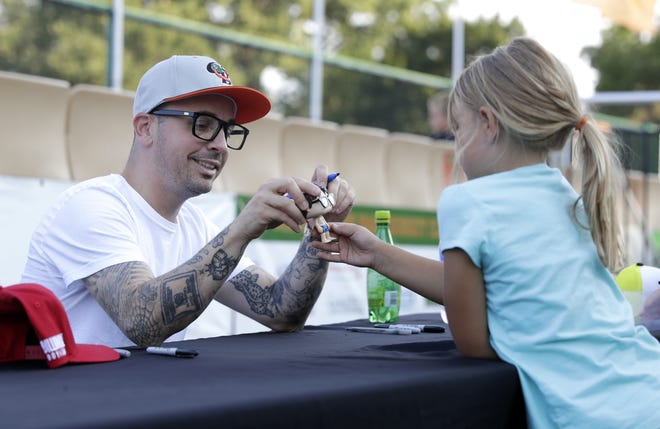 """Chauncey Leopardi, who played of Michael """"Squints"""" Palledorous in the 1993 film """"The Sandlot,"""" signs autographs for fans Thursday at the Green Bay Bullfrogs game at Joannes Stadium."""