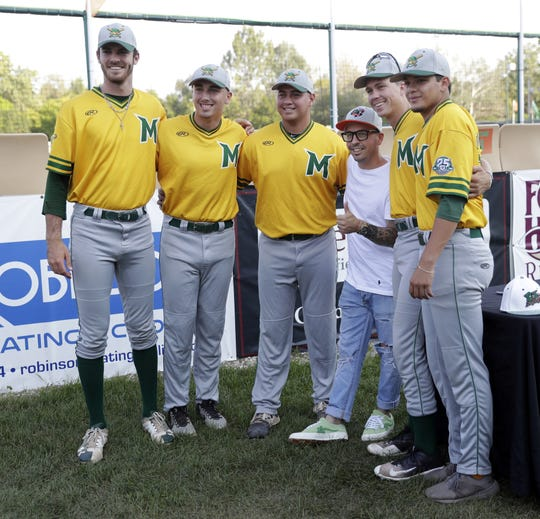 """Chauncey Leopardi, who played of Michael """"Squints"""" Palledorous in the 1993 film """"The Sandlot,"""" takes a photo Aug. 9, 2018 with a group of Madison Mallards before their game against the Green Bay Bullfrogs at Joannes Stadium in Green Bay, Wis. Sarah Kloepping/USA TODAY NETWORK-Wisconsin"""