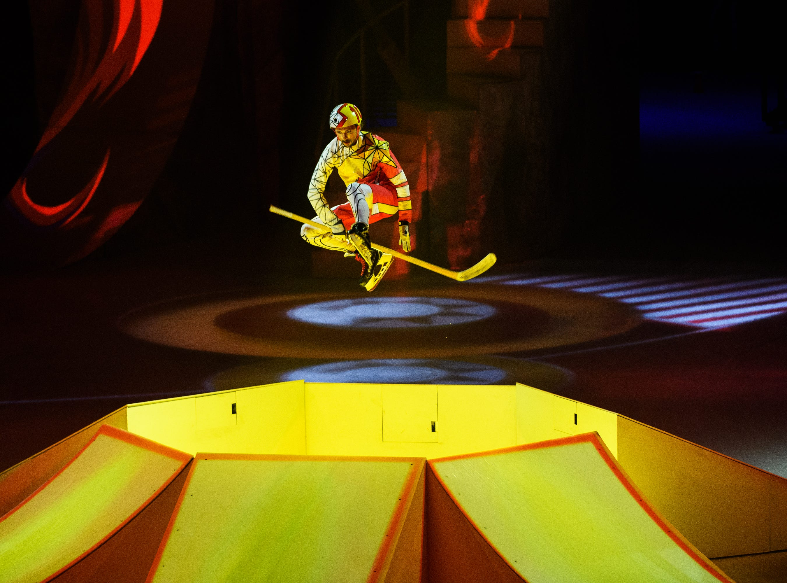 """Cirque du Soleil performer jumps off a ramp on ice skates during their show """"CRYSTAL,"""" at the Bon Secours Wellness Arena on Thursday, Aug. 9, 2018."""