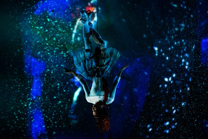 """A Cirque du Soleil performer is lowered onto the ice during their show """"CRYSTAL,"""" at the Bon Secours Wellness Arena on Thursday, Aug. 9, 2018. The performance will run in Greenville until Sunday, Aug. 12."""
