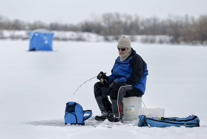 In this 2015 photo, Jeff Wholer ice fishes for rainbow trout at Wadsworth Lake.