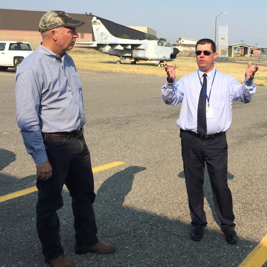 Jeff Wadekamper, director of the Helena Regional Airport, right, talks with Rep. Greg Gianforte on Friday about the Rocky Mountain Emergency Services Training Center.
