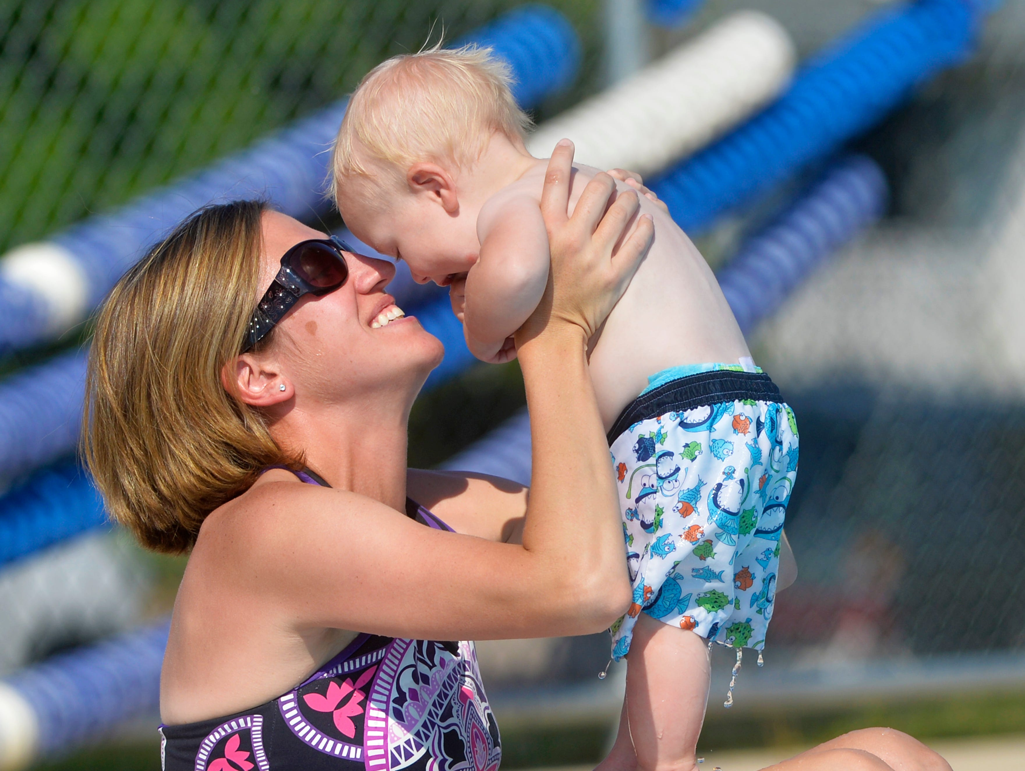 Megan Graham cools off at the Water Tower Pool with her son Jimmer, age 9 mo., Thursday day afternoon.