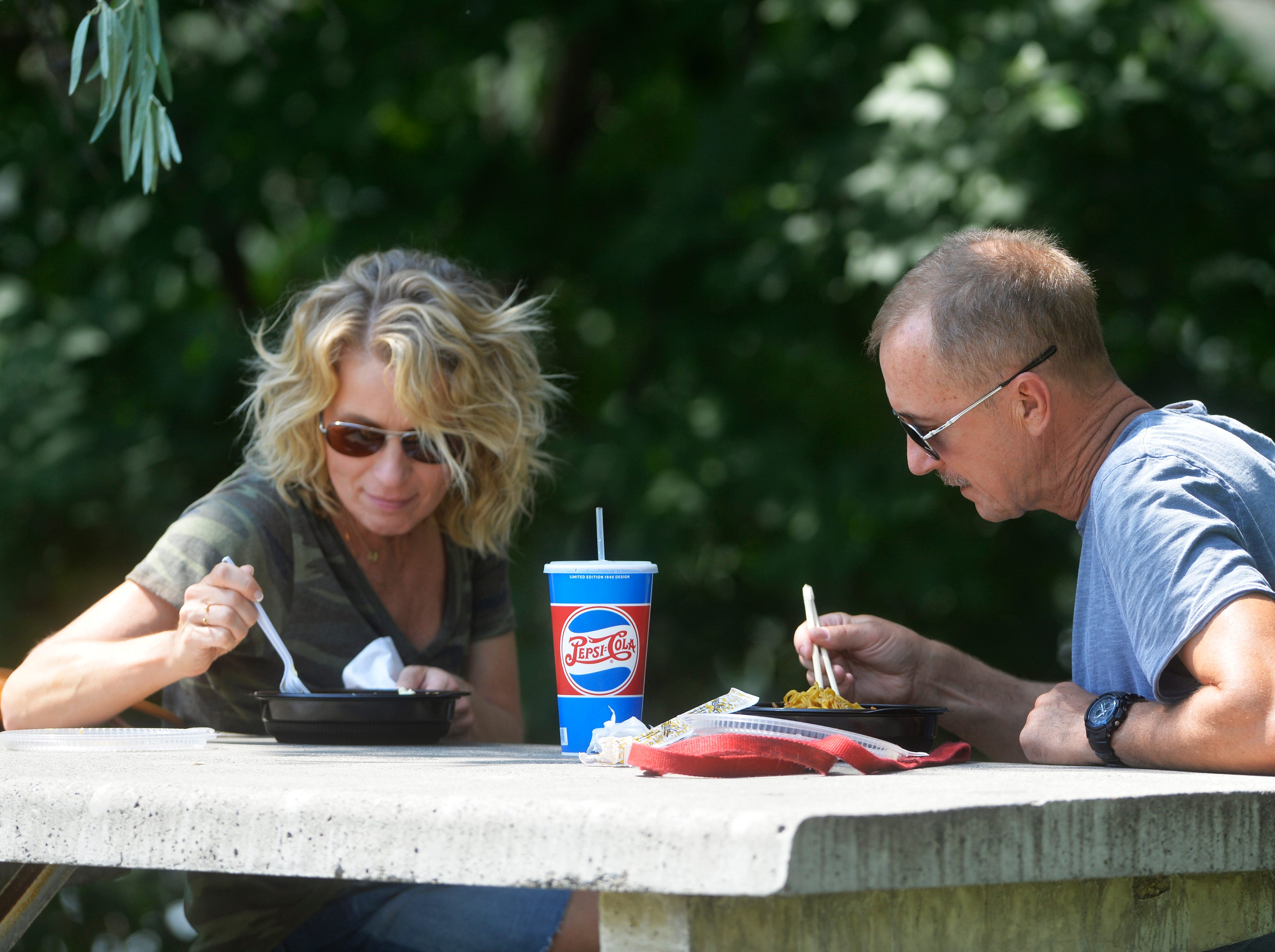 Lisa and Tim Ranes enjoy lunch in the shade on Thursday at Broadwater Bay.  A high of 101 degrees was recorded in Great Falls late Thursday afternoon.