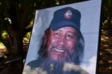 """Friends and family of the late Chamoru seafarer Ignacio """"Nash"""" Camacho, participate in a traditional sendoff ceremony at the Guam National Wildlife Refuge Ritidian Unit on Aug. 10, 2018."""