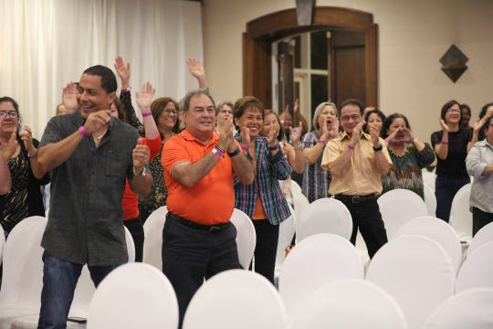 The crowd cheers for their candidates during the Filipino Community of Guam's gubernatorial candidates forum.