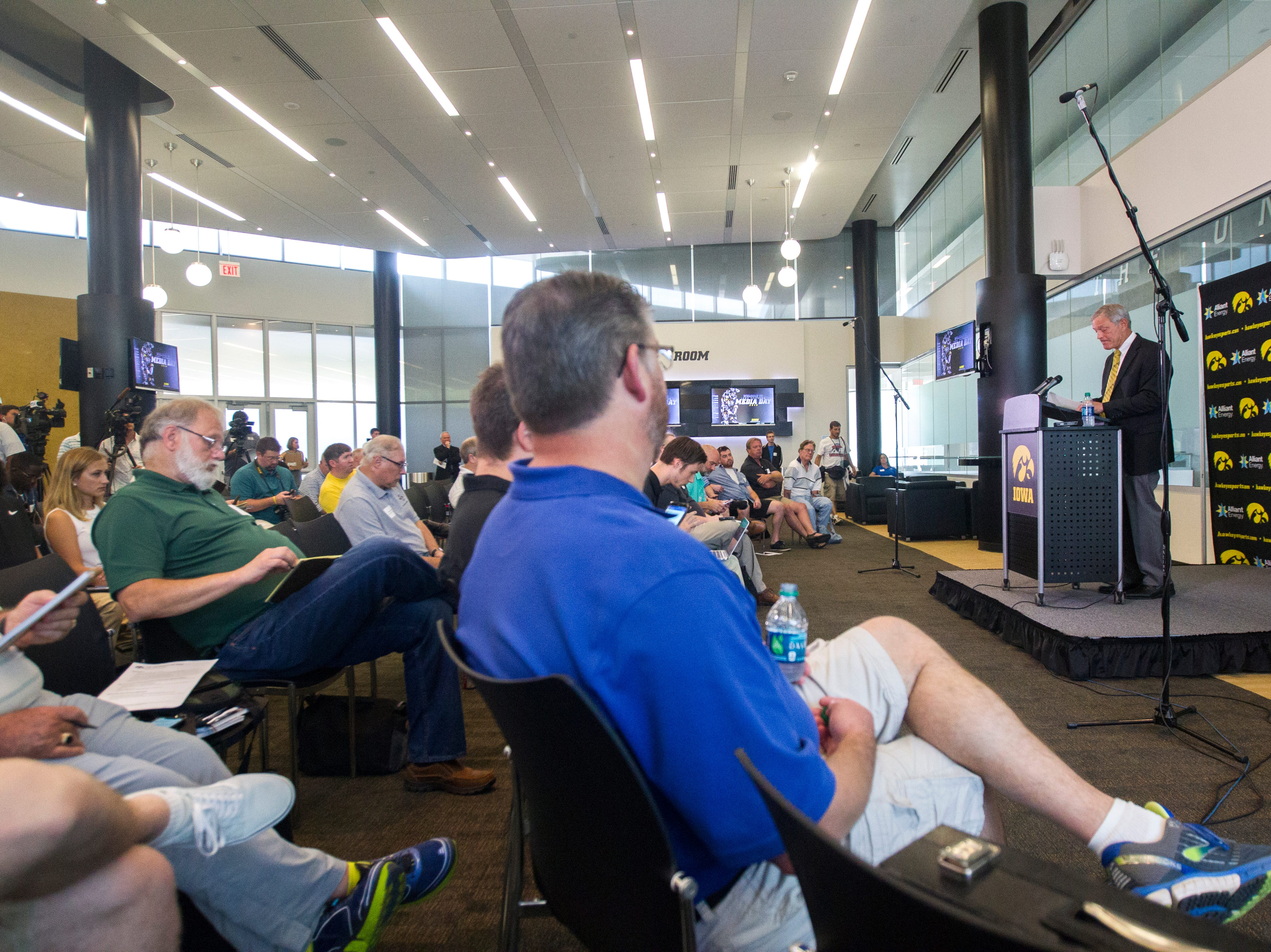 Iowa head coach Kirk Ferentz speaks to reporters during Iowa football media day on Friday, Aug. 10, 2018, in Carver-Hawkeye Arena in Iowa City.