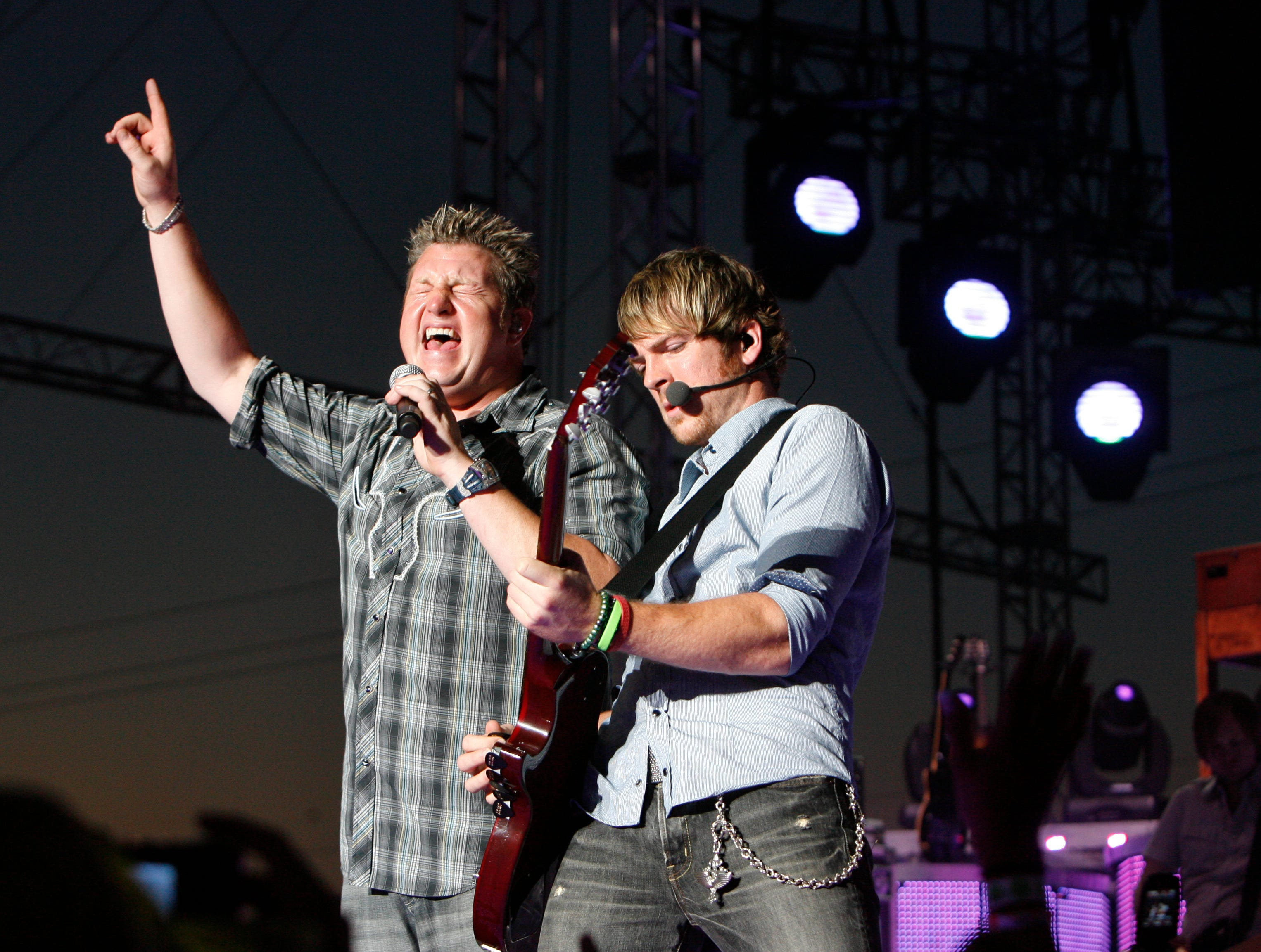 Rascal Flatts vocalist Gary LeVox and guitarist Joe Don Rooney perform together at the Rascal Flatts concert at the Grandstand at the 2007 Indiana State Fair Friday August 10.