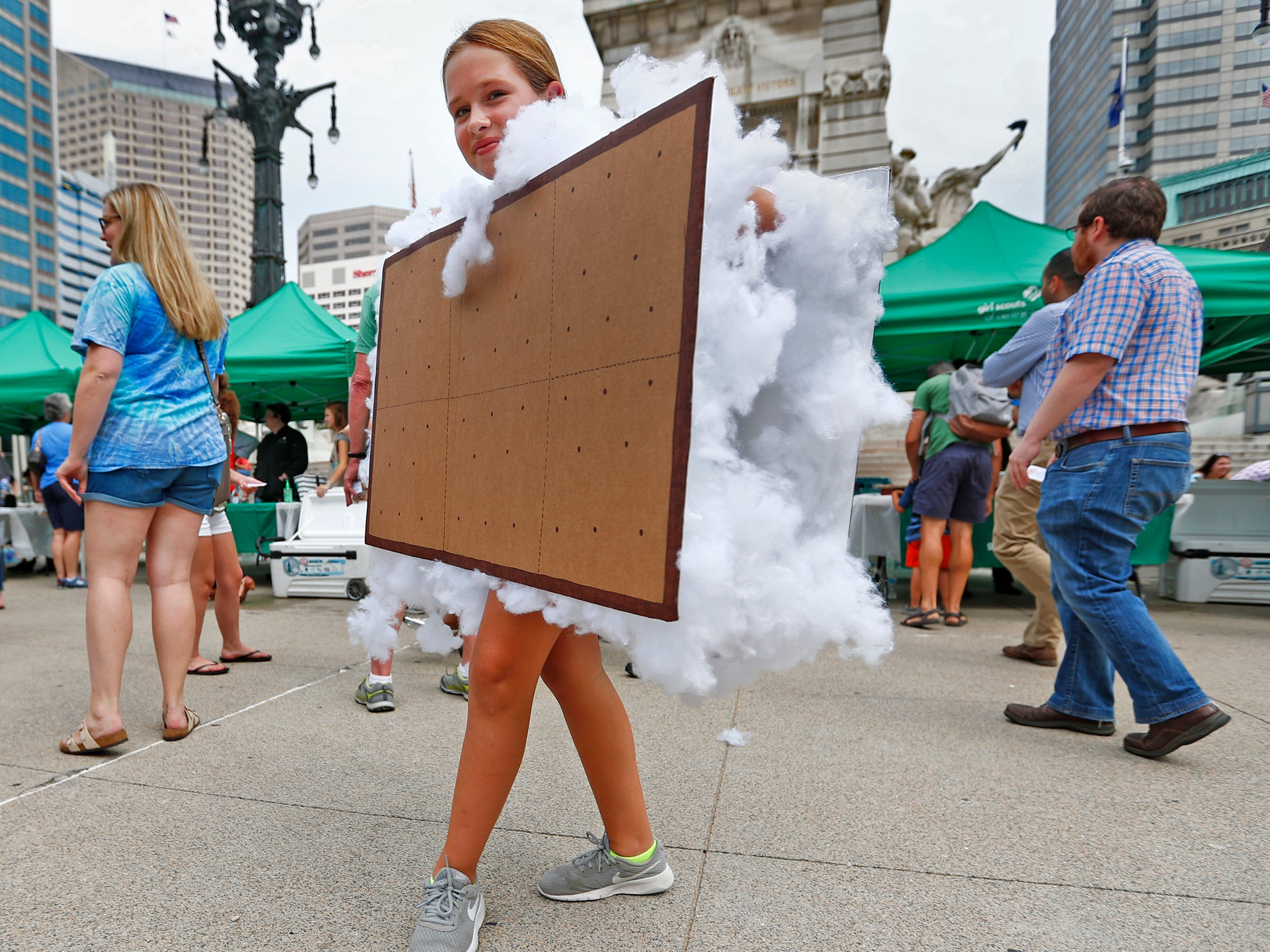 Evie Pendoski dons a s'mores outfit during the Girl Scouts' S'mores on the Circle event, Friday, Aug. 10, 2018.  The event celebrated National S'mores Day.  Seven local chefs were featured, creating gourmet s'mores treats, sold as a fundraiser.  Proceeds go for financial assistance for Girl Scouts, helping all girls who want to be a girl scout participating in hands-on adventures and STEM activities.