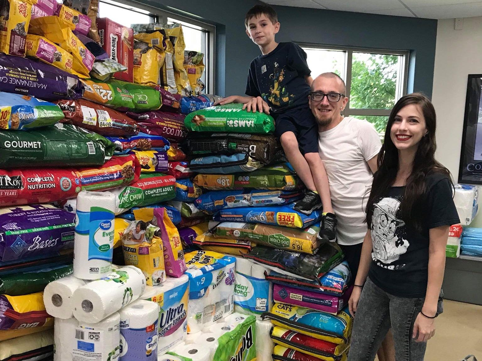 Abby Beck, John Lenegan and Luke Stewart brought in donations to the Hendricks County Animal Shelter Thursday and filled another need. Stacking and sorting the donations that continued to roll in.