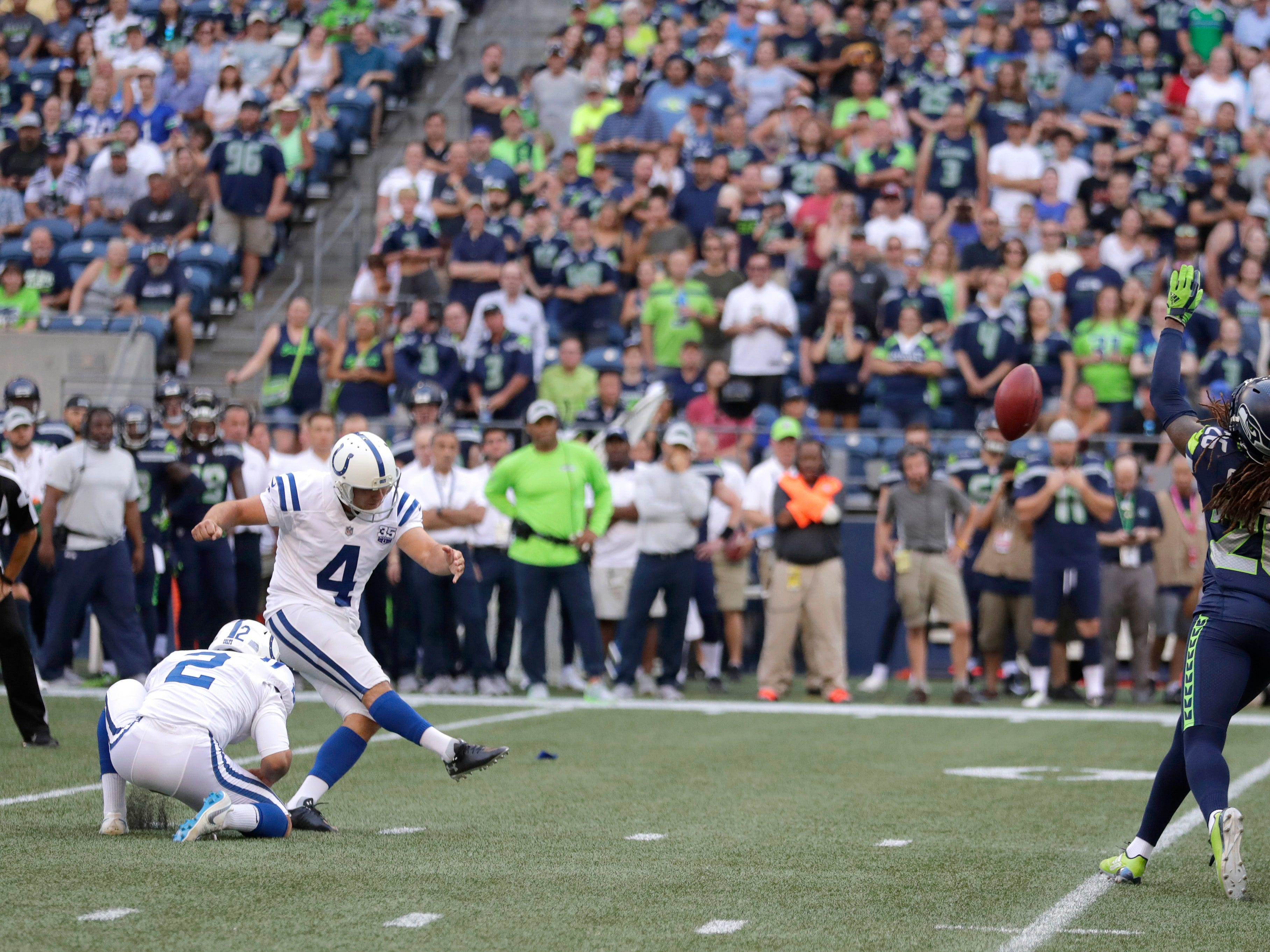 Indianapolis Colts kicker Adam Vinatieri (4) kicks a field goal during the first half of an NFL football preseason game against the Seattle Seahawks, Thursday, Aug. 9, 2018, in Seattle.