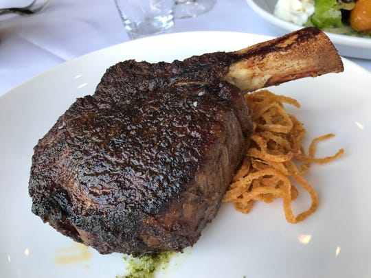 The 2-inch tall Cowgirl Rib-eye is an highly seasoned, 18-ounce bone-in filet with chimichurri sauce and fried onions at Anthony's Chophouse, an upscale steakhouse scheduled to open Aug. 13, 2018, at 201 W. Main St., Carmel.