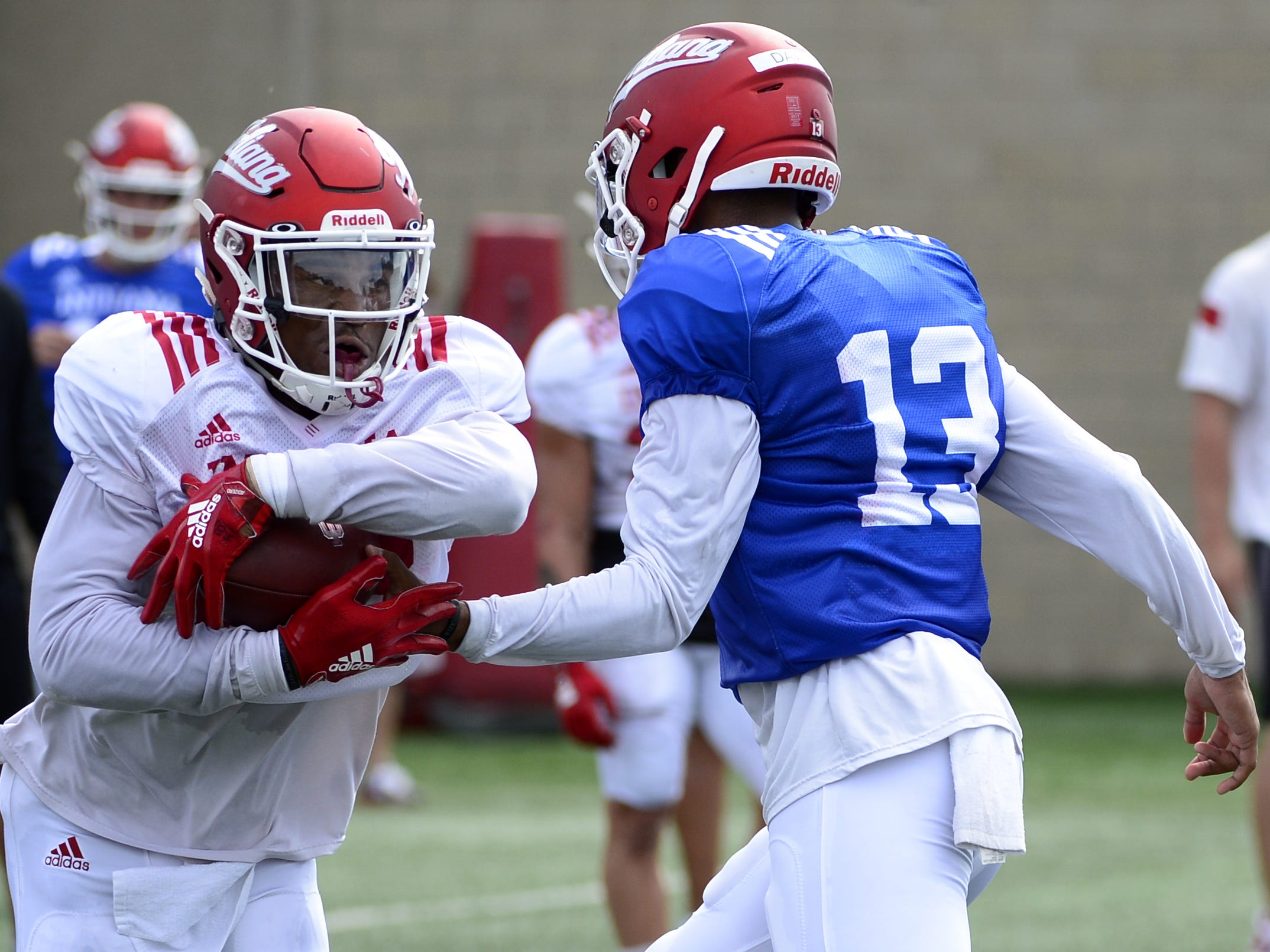 Indiana Hoosiers quarterback Brandon Dawkins (13) hands the ball to running back Kristian Pechac (28) during practice at Mellencamp Pavilion in Bloomington, Ind., on Friday, August 10, 2018.