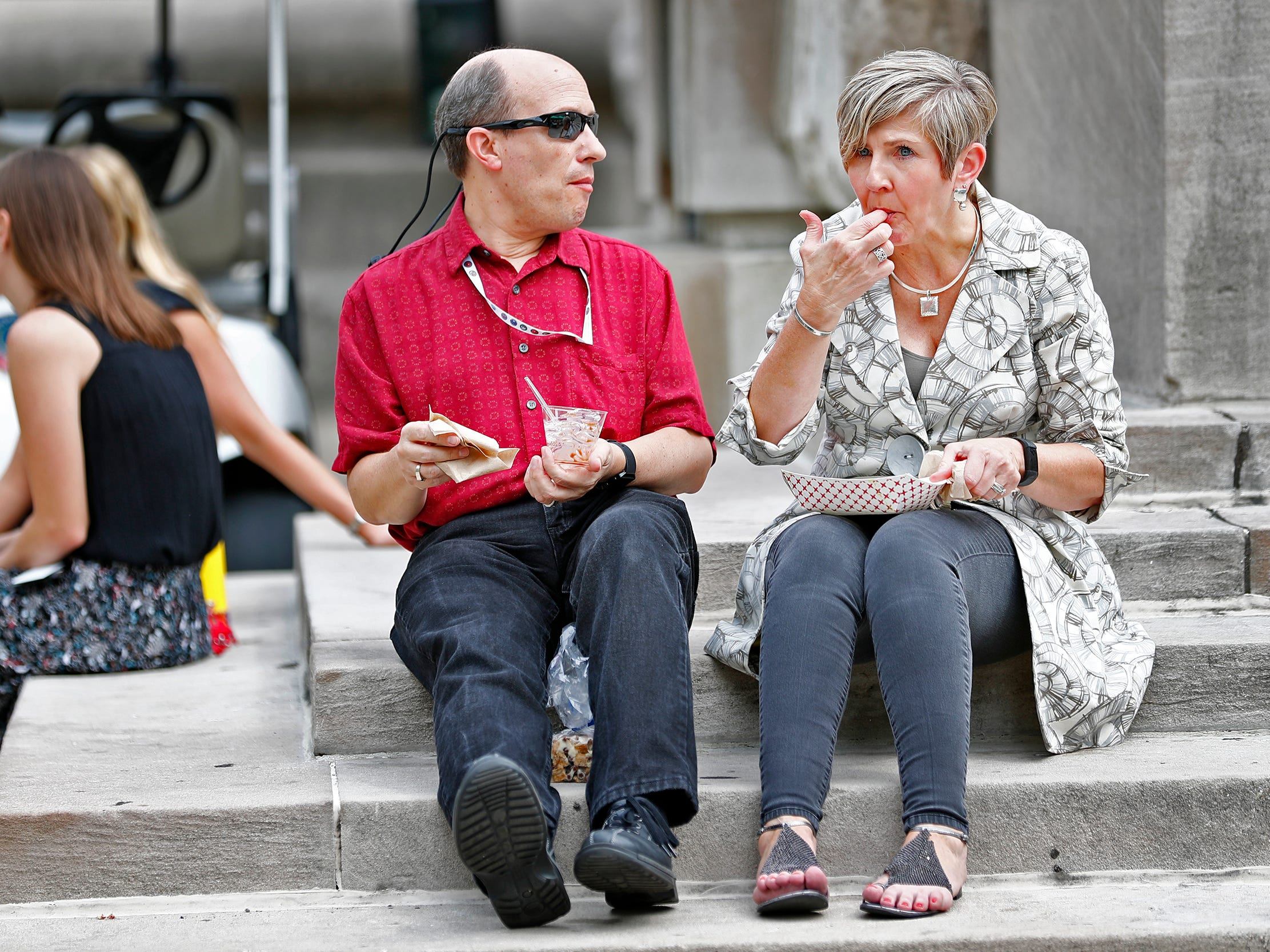 Ken and Teresa Graham enjoy a tasty treat during their lunch break at the Girl Scouts' S'mores on the Circle event, Friday, Aug. 10, 2018.  The event celebrated National S'mores Day.  Seven local chefs were featured, creating gourmet s'mores treats, sold as a fundraiser.  Proceeds go for financial assistance for Girl Scouts, helping all girls who want to be a girl scout participating in hands-on adventures and STEM activities.