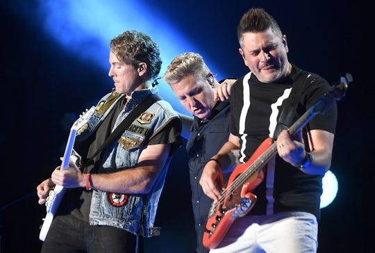 Rascal Flatts (from left, Joe Don Rooney, Gary Levox and Jay DeMarcus) will perform June 11 at Ruoff Music Center.