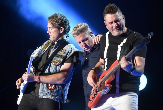 Rascal Flatts (from left, Joe Don Rooney, Gary Levox and Jay DeMarcus) is shown during a June 1 performance in Memphis, Tenn.