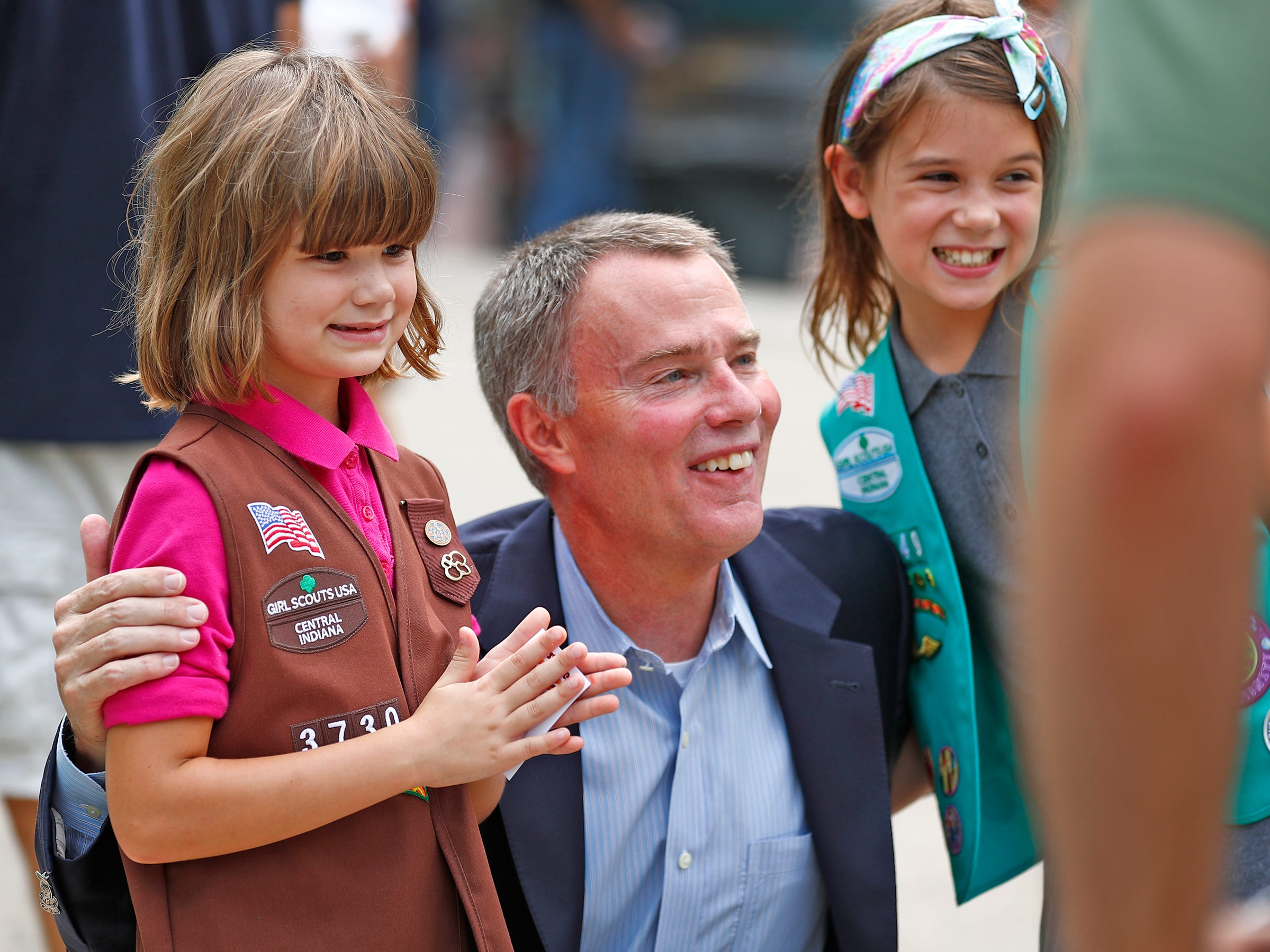 Marian and Vera McConnell, sisters, pose with Mayor Joe Hogsett during the Girl Scouts' S'mores on the Circle event, Friday, Aug. 10, 2018.  The event celebrated National S'mores Day.  Seven local chefs were featured, creating gourmet s'mores treats, sold as a fundraiser.  Proceeds go for financial assistance for Girl Scouts, helping all girls who want to be a girl scout participating in hands-on adventures and STEM activities.