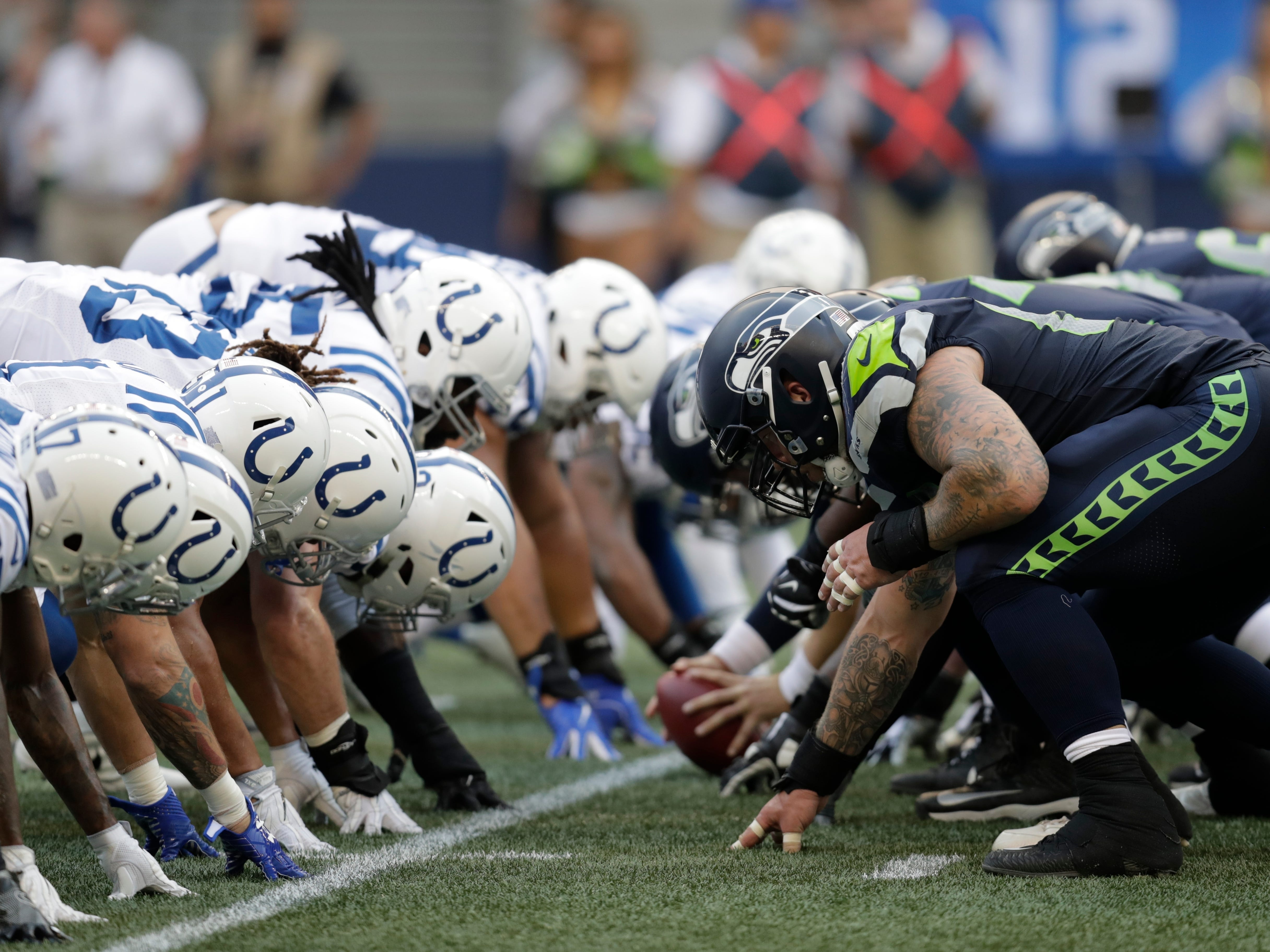 Seattle Seahawks and Indianapolis Colts players line up on the line of scrimmage during the first half of an NFL football preseason game, Thursday, Aug. 9, 2018, in Seattle.