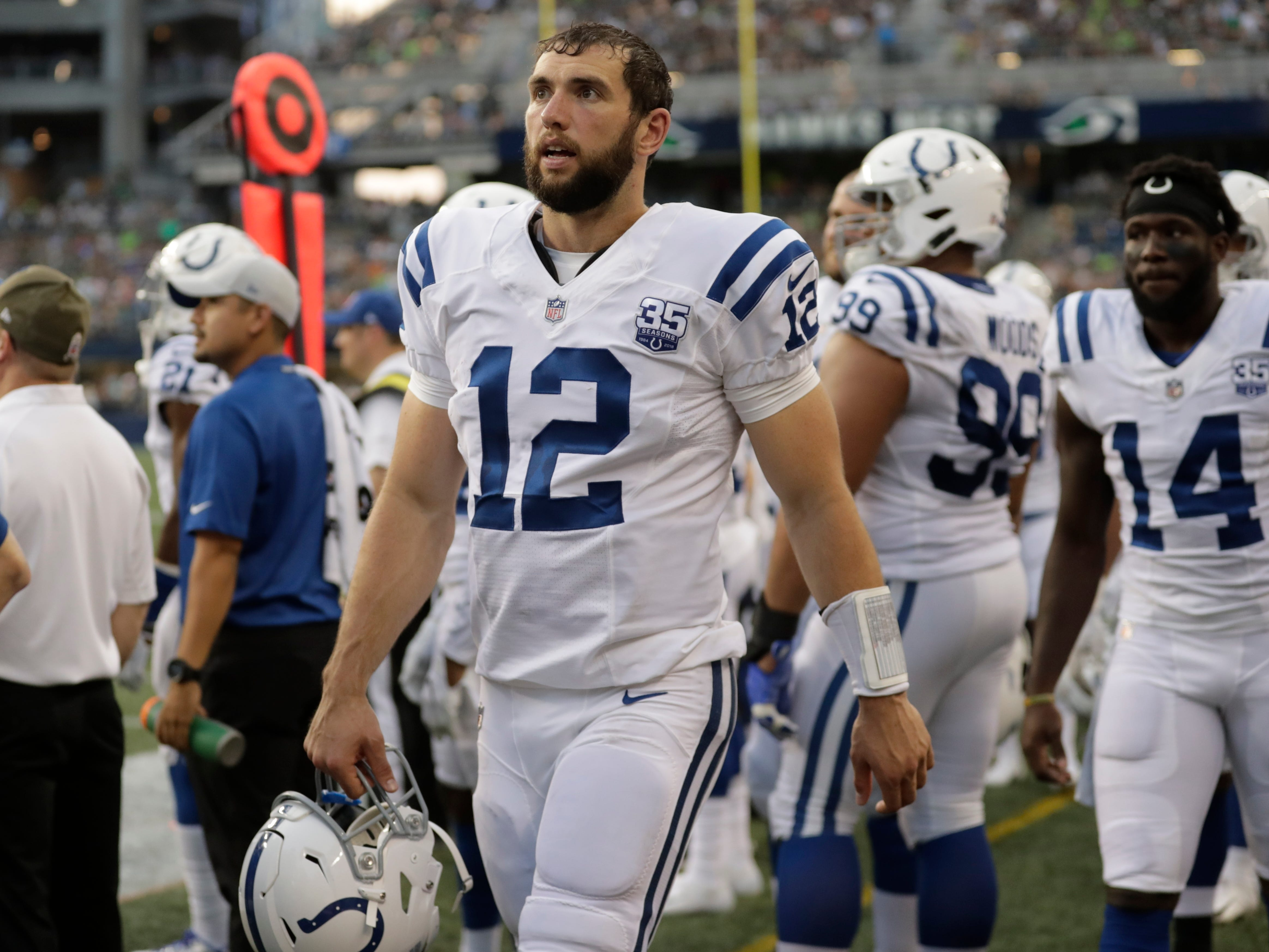 Indianapolis Colts quarterback Andrew Luck reacts on the sideline during the first half of an NFL football preseason game against the Seattle Seahawks, Thursday, Aug. 9, 2018, in Seattle.