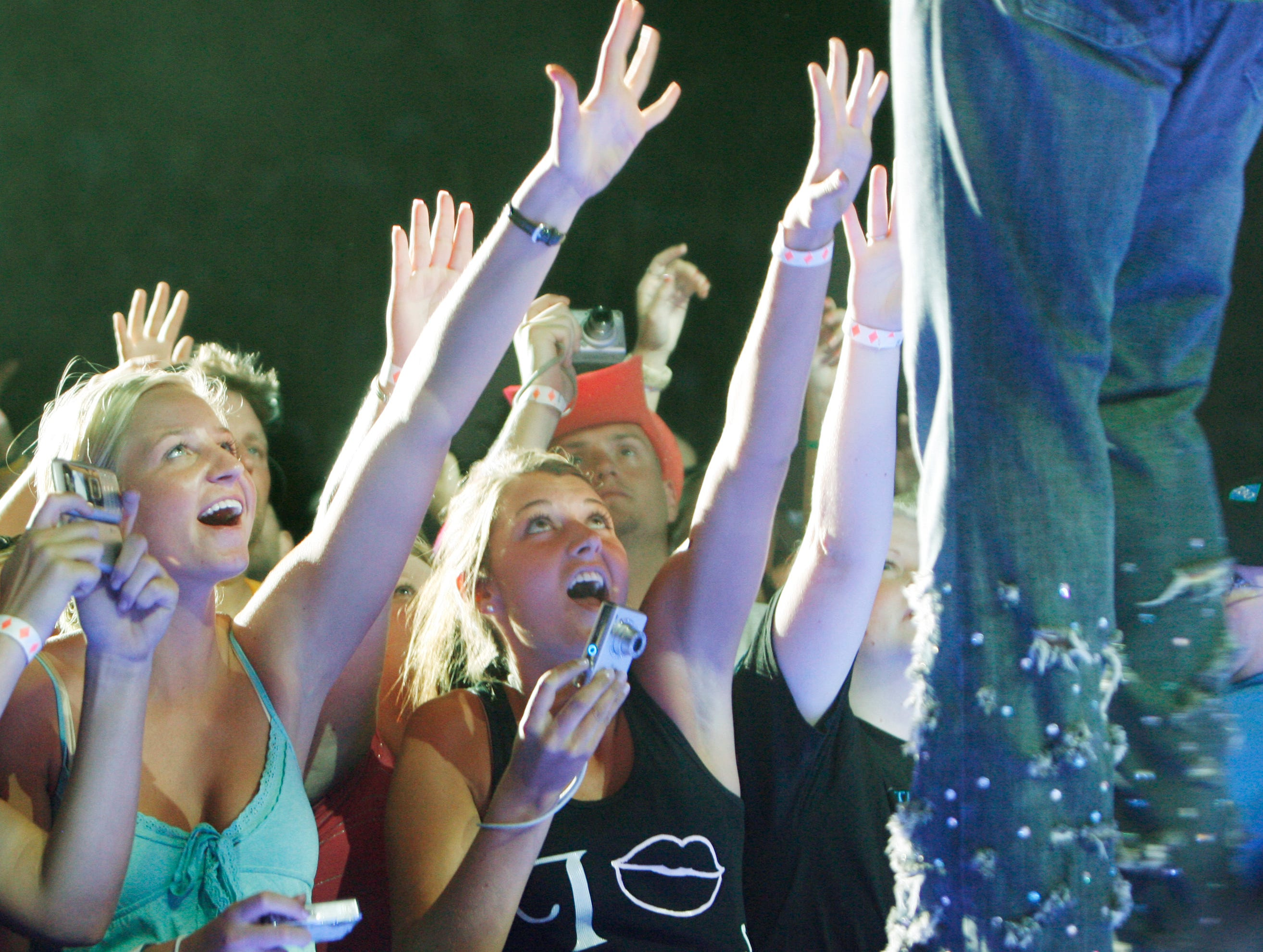 Female fans reach up to Rascal Flatts vocalist Gary LeVox in action at the Rascal Flatts concert at the Grandstand at the 2007 Indiana State Fair Friday August 10.